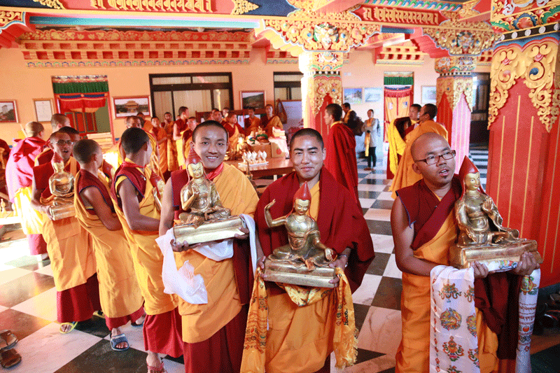 Monks holding offerings in the foyer under the shrine room, preparing to offer to Thrangu Rinpoche, Namo Buddha, Nepal, November, 2012. Photo by Karma Jangchup