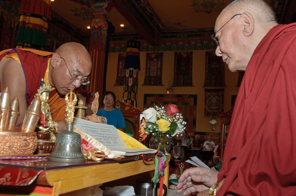 Lodroe Nyima Rinpoche made a Body, Speech, and Mind offering to Khenpo Karthar Rinpoche in the White Tara puja at Karma Triyana Dharmachakra. (photo by Stephanie Colvey)