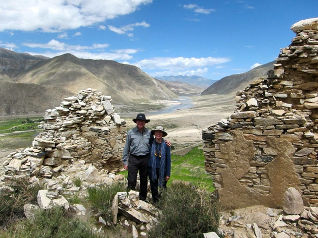 Doug and Karen, in the ruins of the palace above Takten Phuntsok Ling monastery