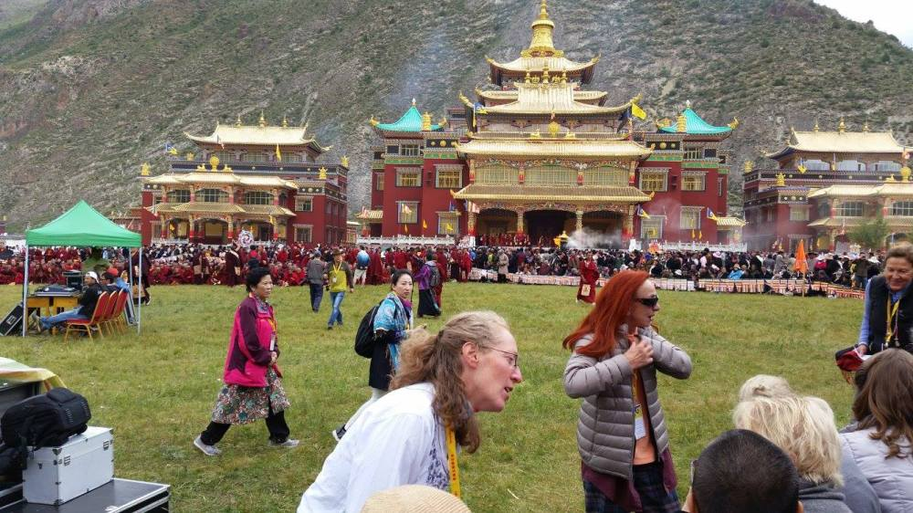 Amy on the lawn of Thrangu Monastery, awaiting our beloved teacher, Khenpo Karthar Rinpoche.