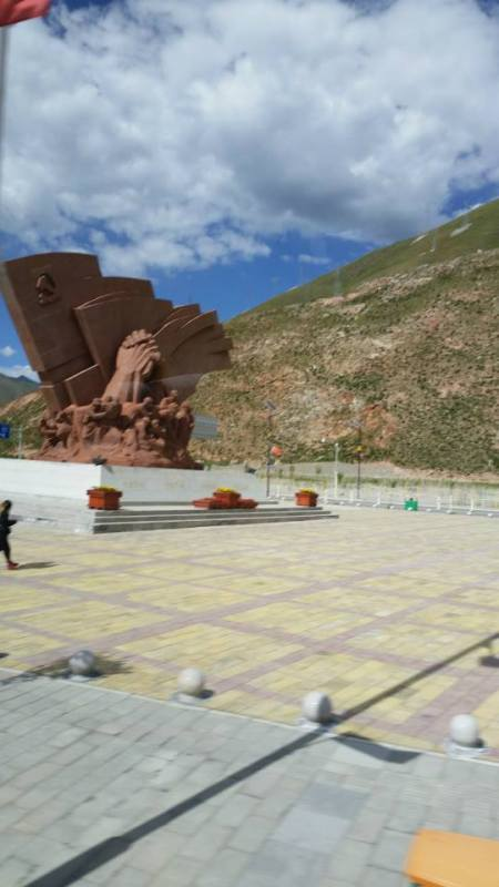 Communist monument representing the governments help in rebuilding Yushu.