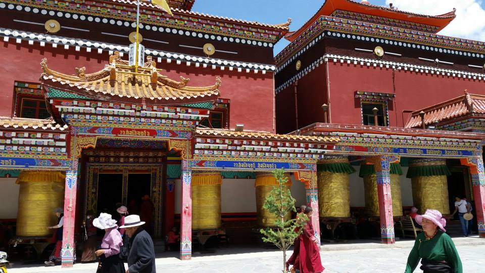 Prayer wheels on front side of mani walls.