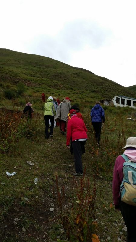Trekking up the mountain to the 3 year retreat site, where Khenpo Karthar Rinpoche did his 3 year retreat.