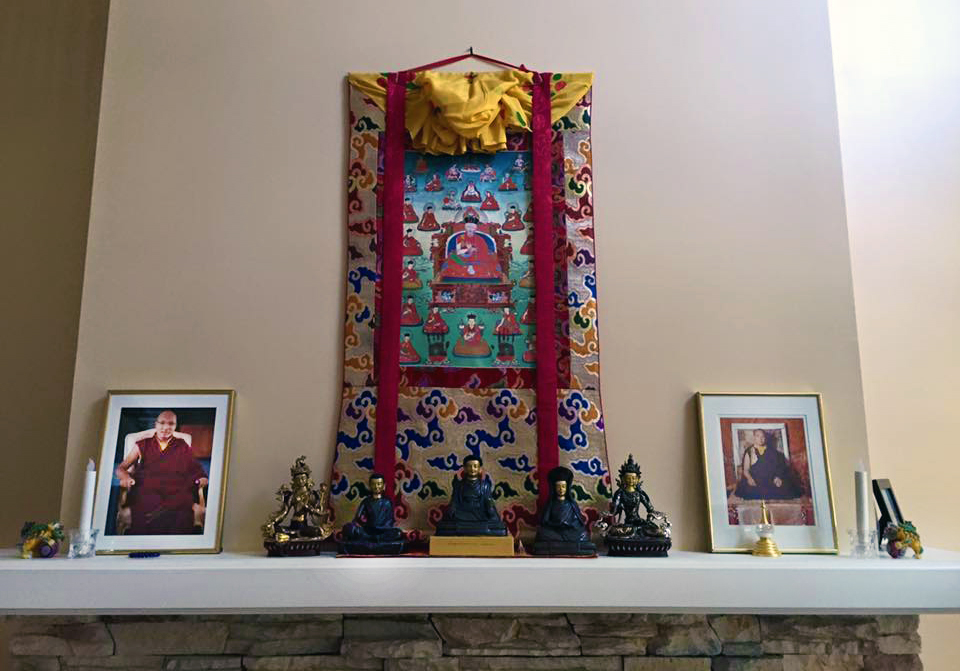Marpa, Milarepa, Gampopa and other masters are honored on the mantle.